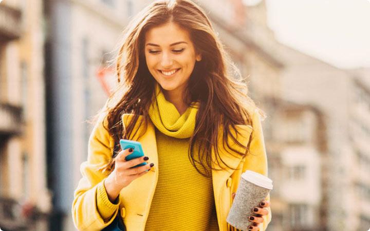 Woman holding cellphone consumer marketing